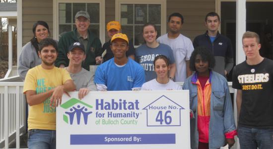 Group serving at Habitat Homesite